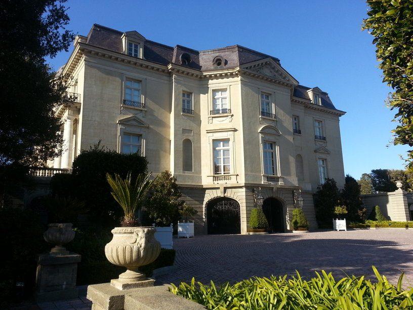 rsz_carolands_chateau-_south_facade_with_porte-cochère_gates_feb13_