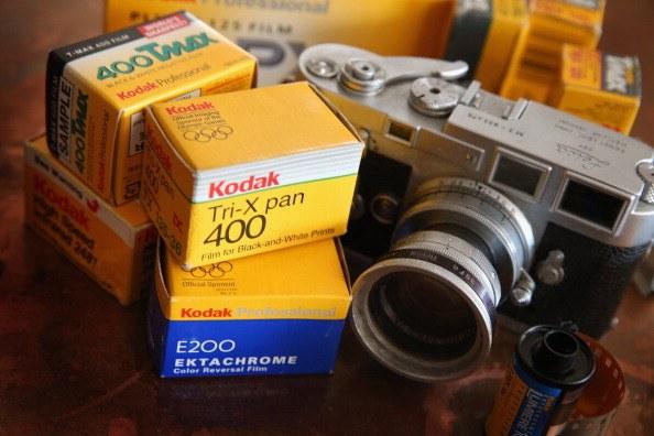 Kodak film is seen alongside a vintage Leica M3 35mm rangefinder camera